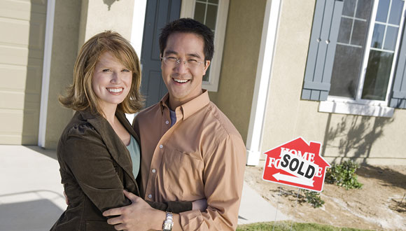 A happy couple who just became new home owners after a great home inspection in Conroe, Southeast Texas.
